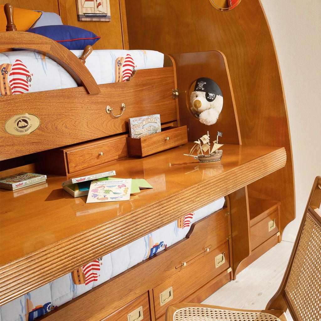 From the bunk bed block there is large pull-out desk with convenient drawers for two stations